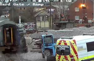 CCTV image showing the rail vehicle moving towards the level crossing gates (courtesy of Mid Norfolk Railway)