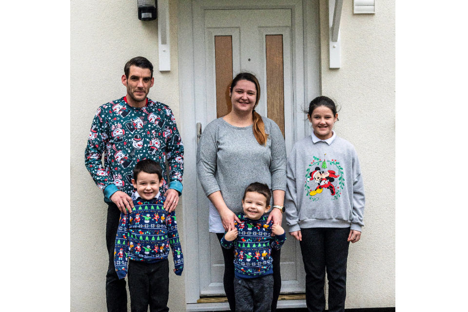 Corporal Angus, his wife Sarah and their children Paige, Bradley and Oscar standing outside their new home.