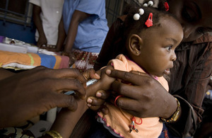 GAVI Alliance: A child receives a vaccine against yellow fever at the Barumbu mother and child center in Kinshasa, DRC. Picture: Olivier Asselin/GAVI Alliance