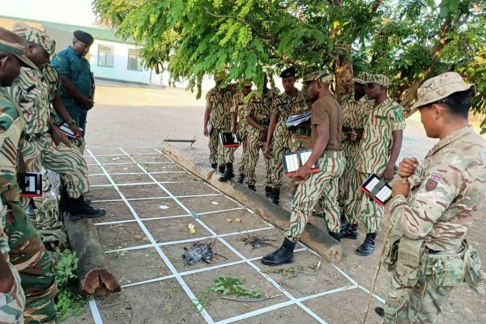 Zambian rangers learning tracking techniques