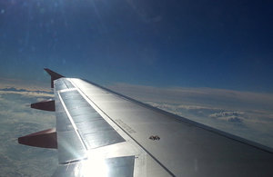 Plane wing over clouds.