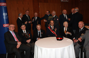 """Ambassador Robin Barnett with the veterans"""