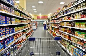 trolley in empty supermarket aisle
