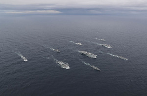 Image depicts the Carrier Strike Group at sea.