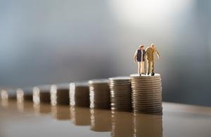 miniature people on coins
