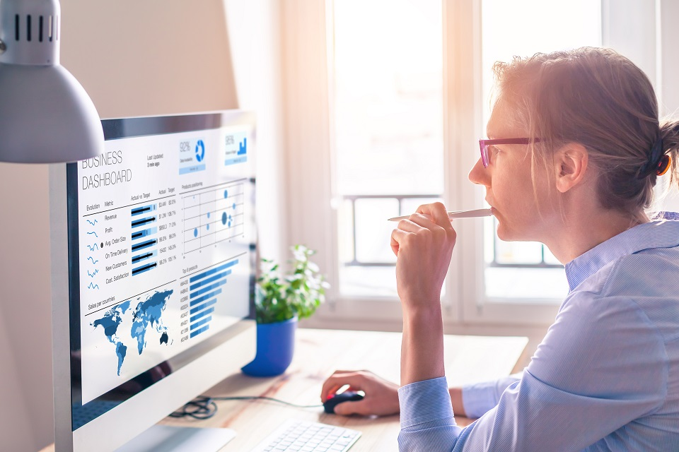 Businesswoman looking at dashboard on screen