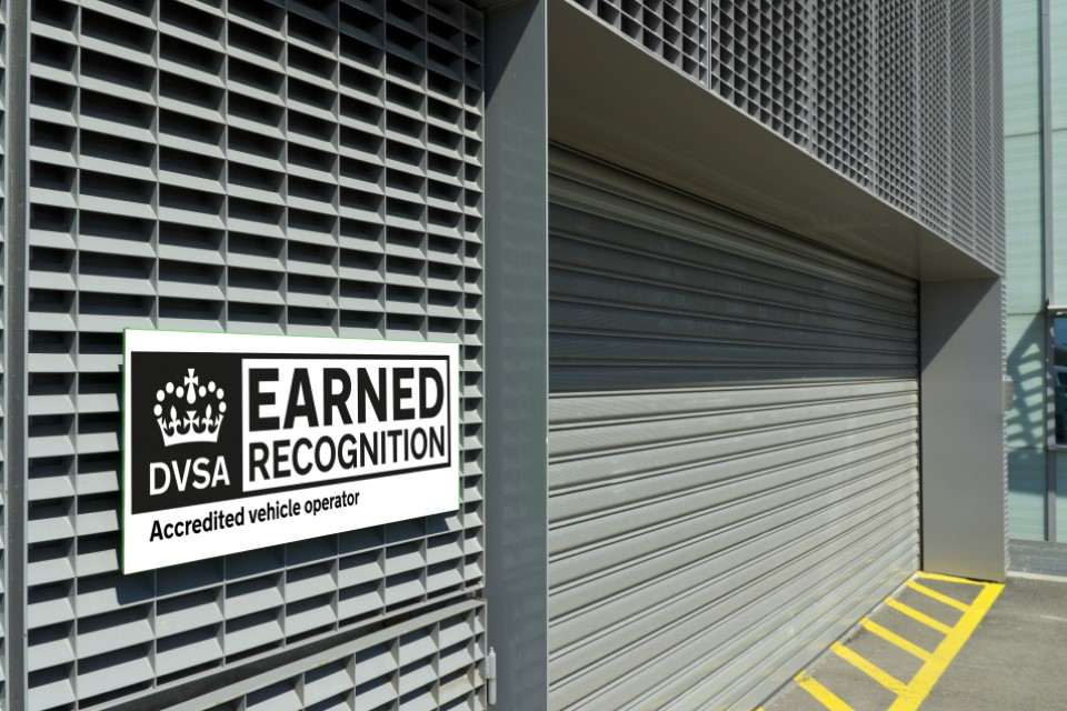 Photo of a DVSA earned recognition logo on the outside of a transport depot
