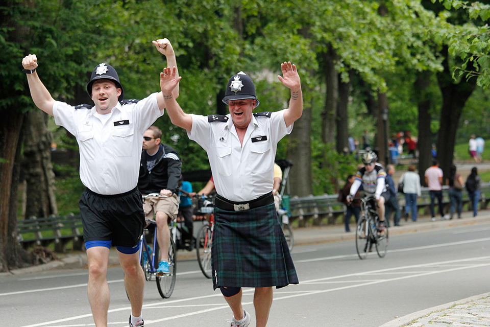 A kilted officer makes his way through Central Park.