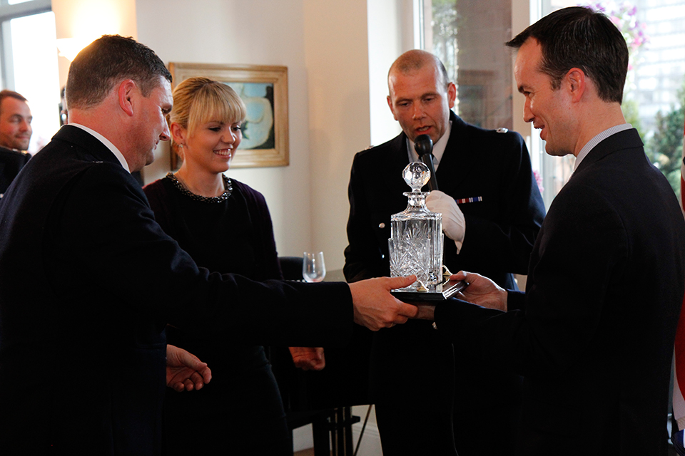 PC Mark Edwards, MBE, and Superintendent Gary Buttercase present Consul General Lopez with Metropolitan Police glassware.