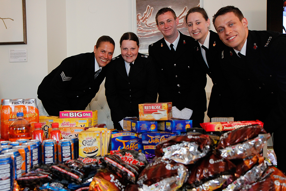 Metropolitan Police present the consulate with British treats to sell for charity on behalf of Jack's PACK.