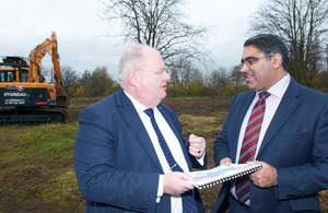 Eric Pickles was shown around a planned advanced manufacturing hub by Councillor Tahir Ali.