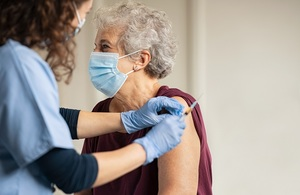Woman being vaccinated