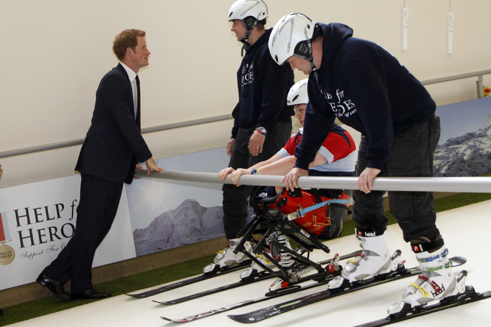 Prince Harry meets wounded servicemen recuperating with the help of a ski simulator