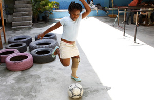 Renane, aged 8, plays football wearing her new prosthetic leg. Picture: Russell Watkins/DFID