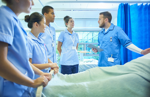 Student nurses around a patient's bed