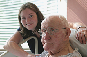 Older man in hospital with young relative