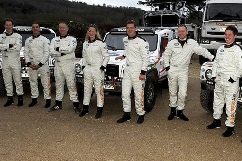 Race2Recovery team members with vehicles