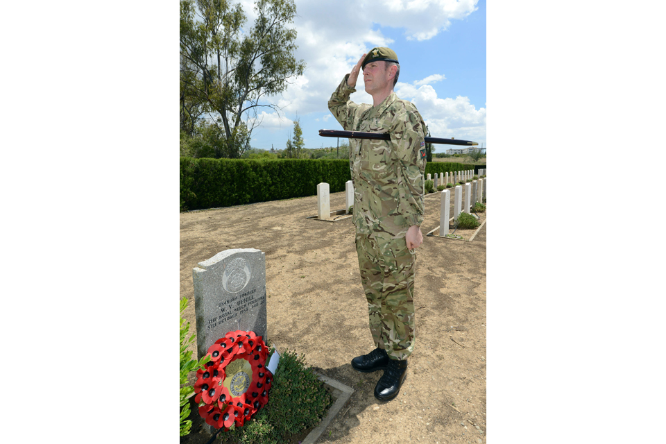 Warrant Officer Class 1 Vic Hughes lays a wreath