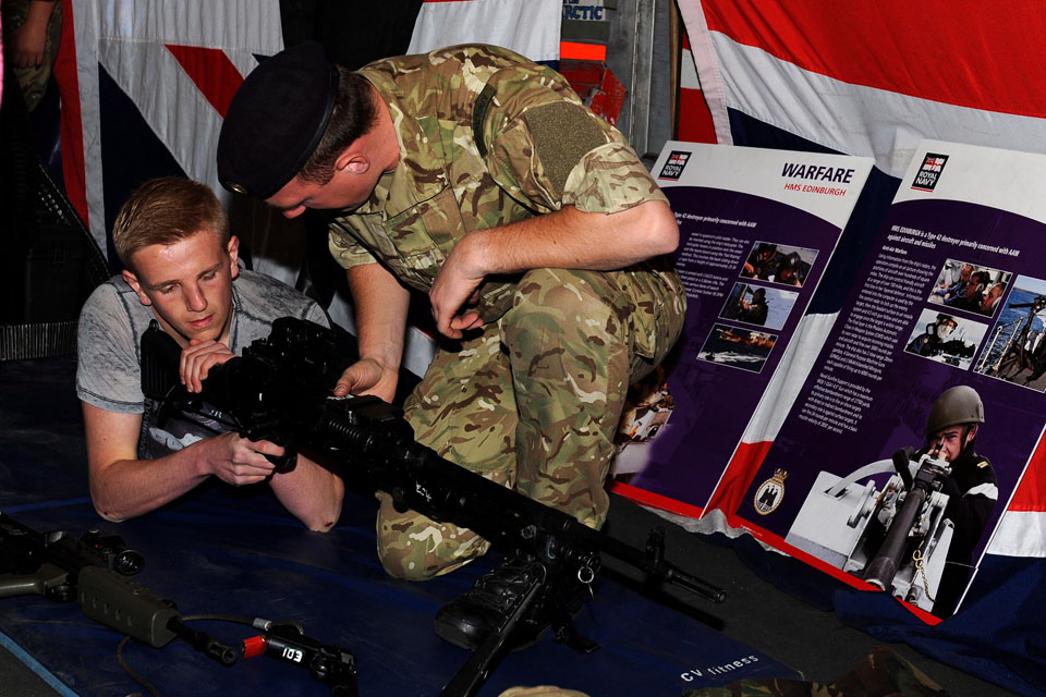 Leading Seaman (Above Water Warfare) 'Tug' Wilson shows a member of the public a general purpose machine gun
