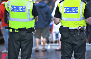 Image of 2 police officers standing.