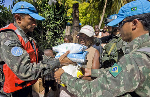 UN Peacekeepers distributing food rations in Haiti