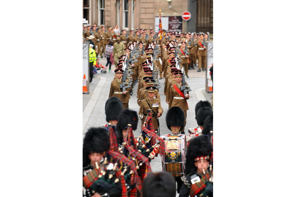 The 1st Battalion Scots Guards march through Inverness