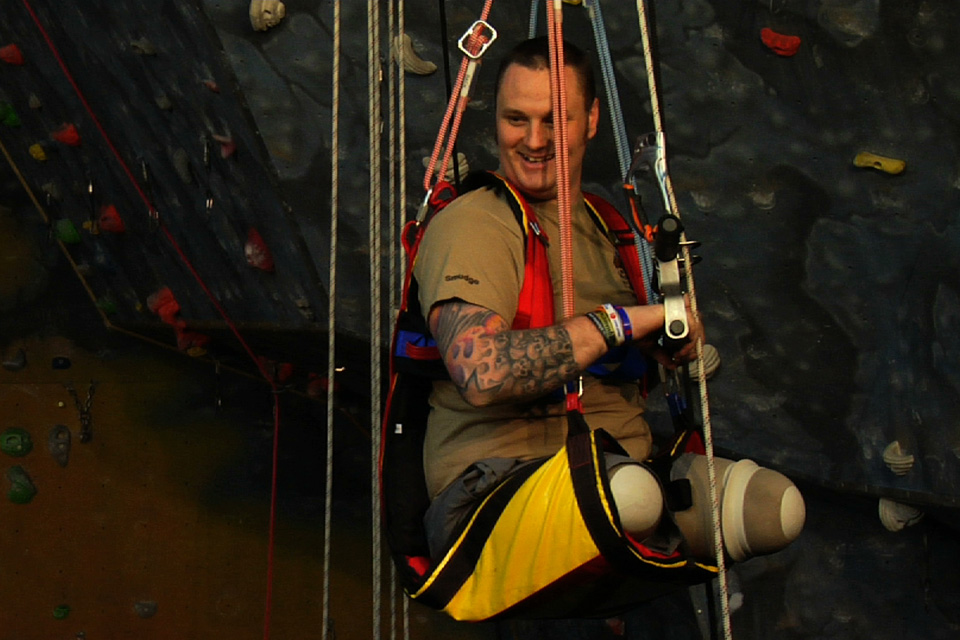 Sapper Clive Smith is hoisted onto a specially adapted climbing wall