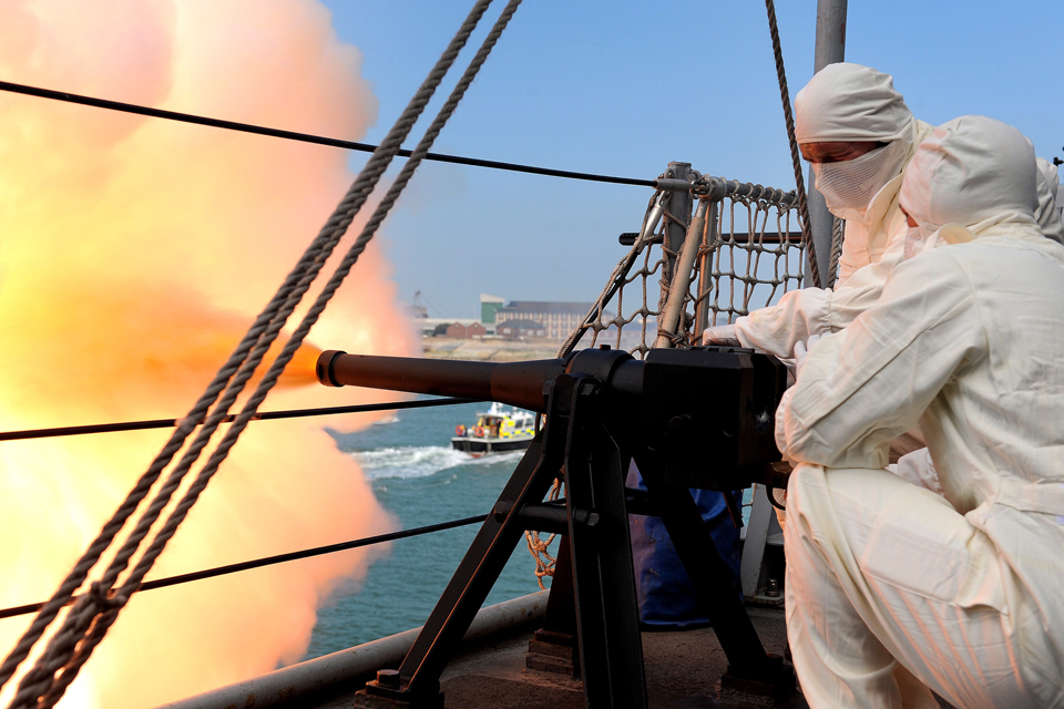 Gunners fire a 21-gun salute from HMS Edinburgh