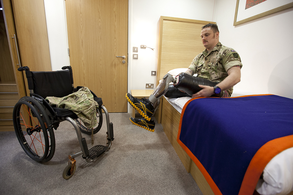 Sapper Clive Smith demonstrates his prosthetic lower limbs