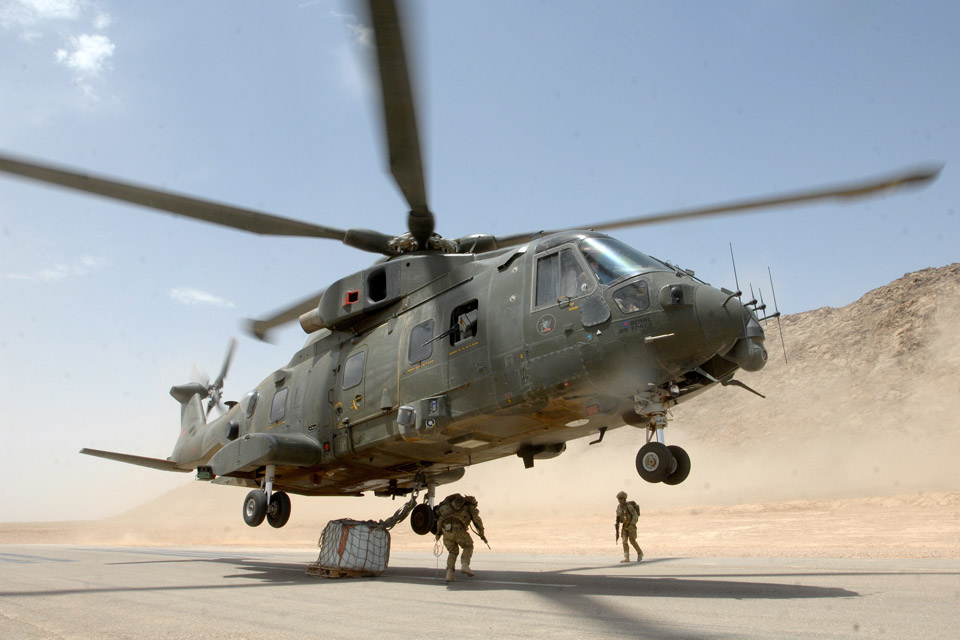 An RAF Merlin helicopter takes off with an underslung load