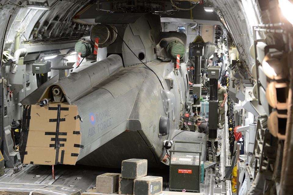 A Merlin helicopter is packed and secured into an RAF C-17
