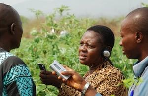 AGFAX journalists interviewing a cassava farmer