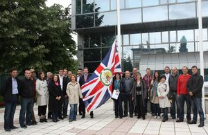Embassy staff in front of the new Embassy building