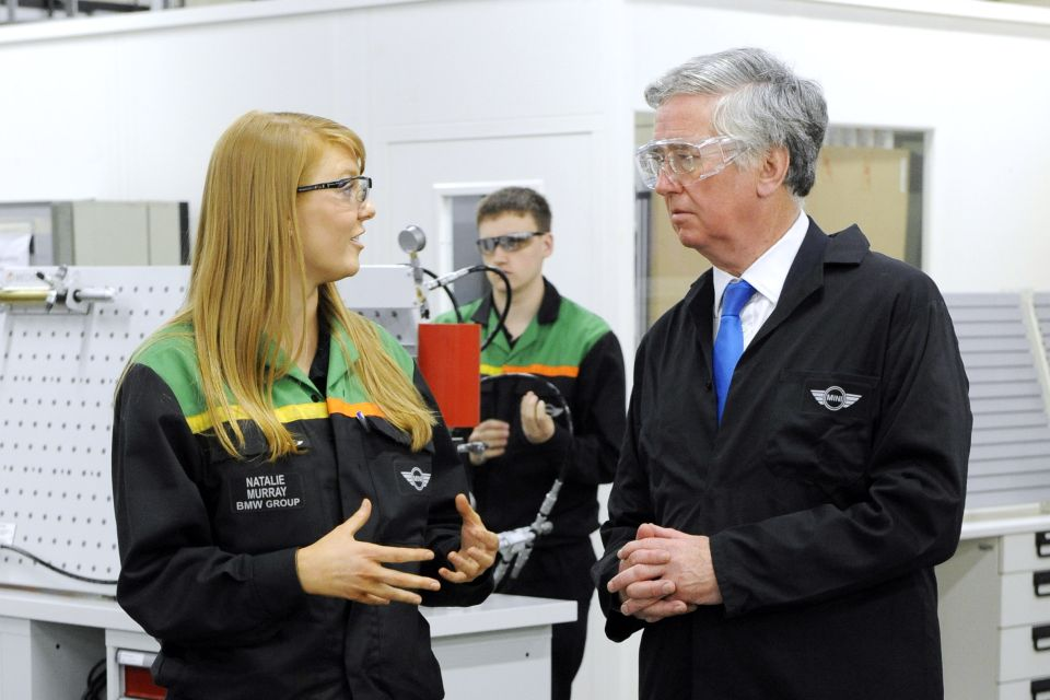 Minister Michael Fallon with Natalie Murray, first-year apprentice, at the MINI Plant Oxford Training School