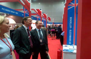 Lord Green (centre-middle) visiting UK Pavilion at the Oil & Gas Asia Conference 2013