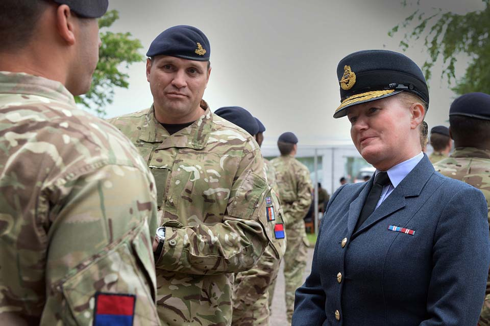 Air Commodore Jane Millington presents medals to soldiers