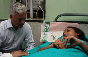Development Minister Alan Duncan speaks with Rabeya, who was paralysed in the Rana Plaza factory collapse.