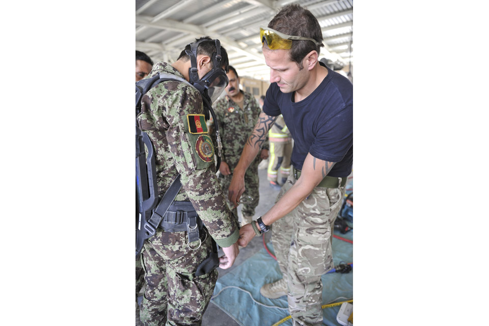 An Afghan firefighter is trained by RAF personnel
