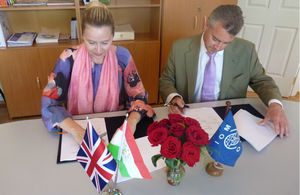 HM Ambassador Robin Ord-Smith (from left) and Tajma Kurt Head of Mission of IOM