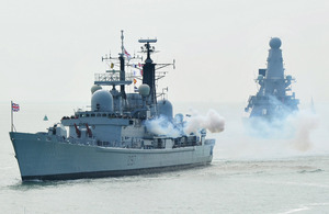 HMS Edinburgh's port side smokes after firing a 21-gun salute on her final entry into Portsmouth – Type 45 destroyer HMS Defender follows in her wake [Picture: Leading Airman (Photographer) Guy Pool, Crown copyright]