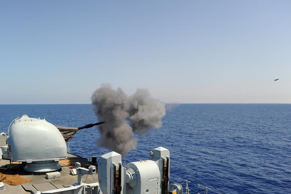 HMS Liverpool fires her 4.5-inch gun
