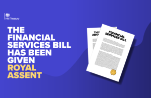 """A graphic showing an image of a pile of documents. The text next to the image reads: """"The Financial Services Bill has been given Royal Assent"""""""