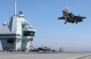 An RAF F-35B fighter jet lands on board HMS Queen Elizabeth