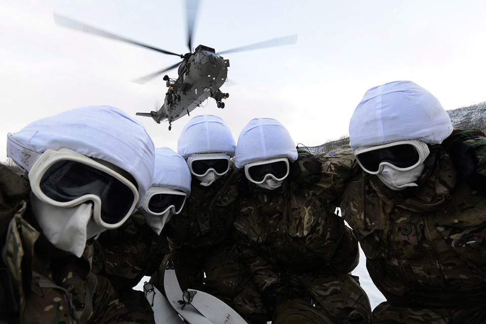 Royal Marines conducting a helicopter embarkation drill
