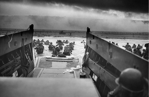 US troops wade ashore on Omaha Beach on the morning of 6 June 1944.