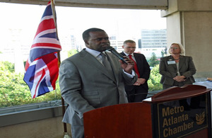 Atlanta Mayor Kasim Reed speaks to a crowd of business and education leaders at the Metro Atlanta Chamber's rooftop pavilion during a reception for the Newcastle delegates.