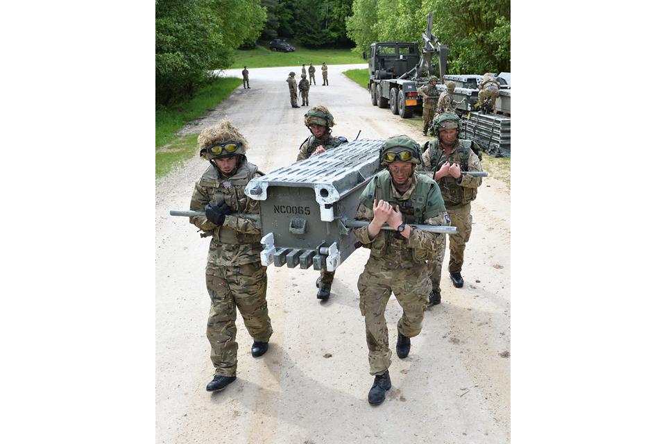 Soldiers build a 5-bay medium girder bridge