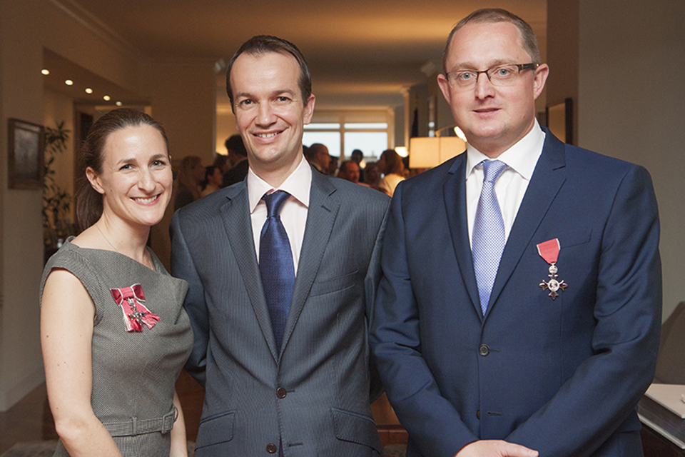 Rebecca Cousins, MBE, Consul General Danny Lopez, and Rich Sexton, MBE