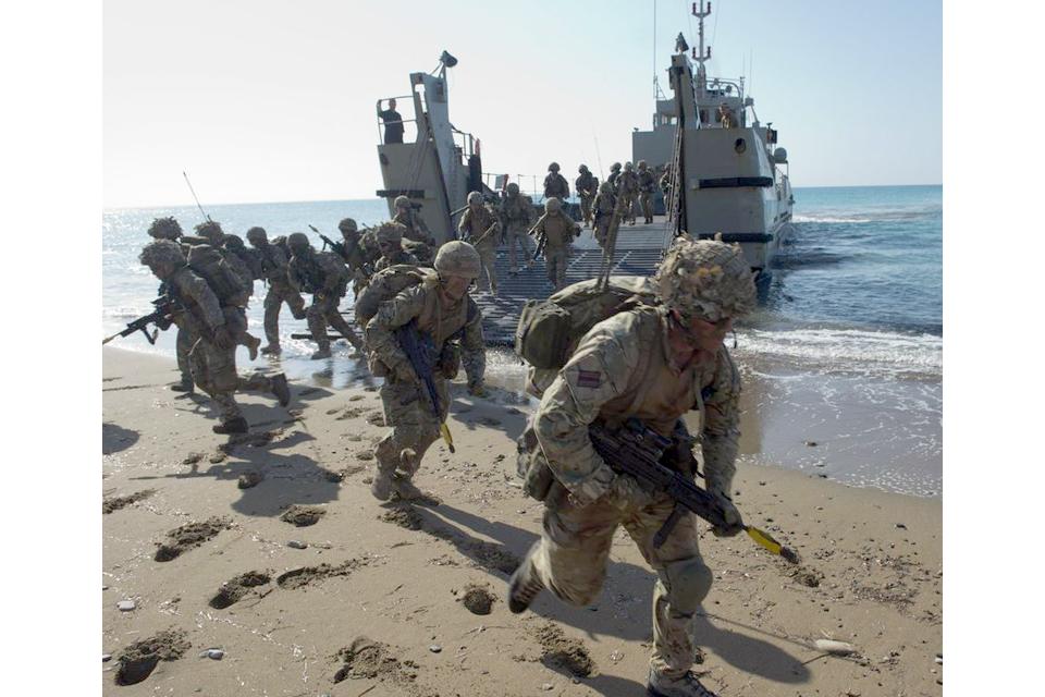 Riflemen taking part in a beach landing during Exercise Lion Star 3