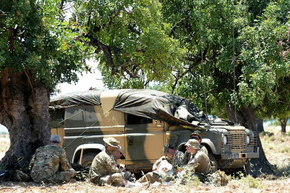 Riflemen take a break in the 37-degree heat